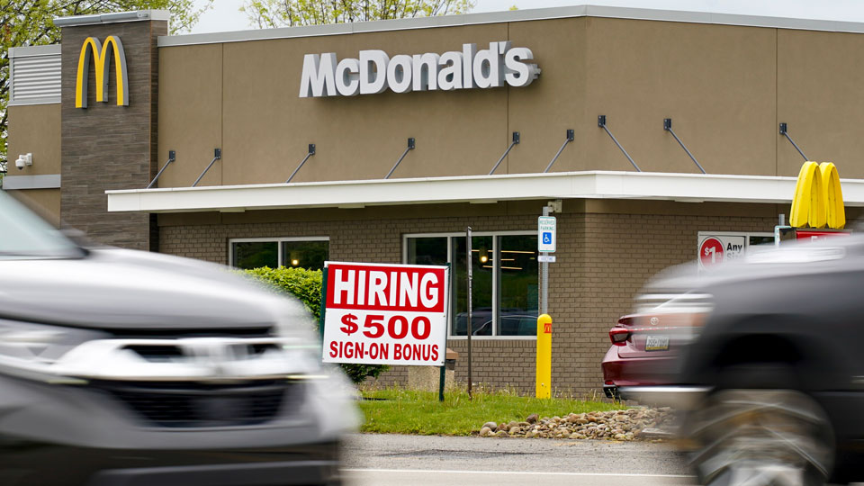 A hiring sign offers a $500 bonus outside a McDonalds restaurant, in Cranberry Township, Butler County, Pa.