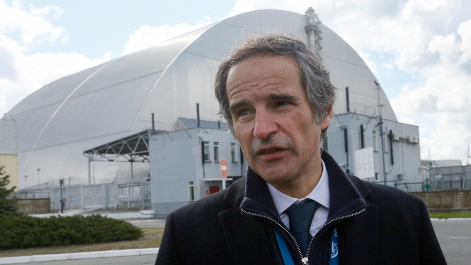 In this April 27, 2021 file photo, Director general of the International Atomic Energy Agency, Rafael Mariano Grossi in front of a shelter construction which covers the exploded reactor at the Chernobyl nuclear plant, in Chernobyl,Ukraine.