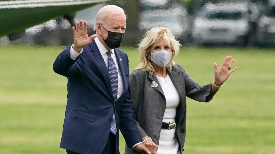 President Joe Biden and first lady Jill Biden wave after stepping off Marine One on the Ellipse near the White House, Monday, May 3, 2021, in Washington.