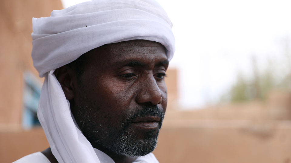 Abdullah Jaber, whose son Mubarak died in a migrant ship sinking last month, sits at his home in Khartoum, Sudan, Friday, April 30 2021