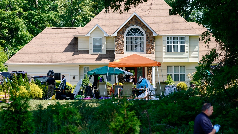 Investigators works the scene of a shooting in Fairfield Township, N.J., Sunday, May 23, 2021.