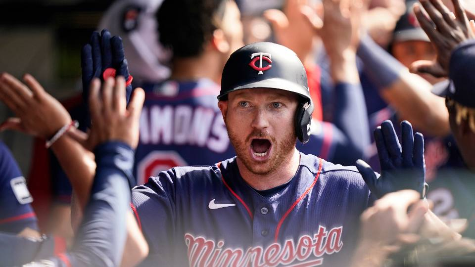 Minnesota Twins' Kyle Garlick celebrates with teammates after he hit a three-run home run in the tenth inning of a baseball game against the Cleveland Indians, Sunday, May 23, 2021, in Cleveland.