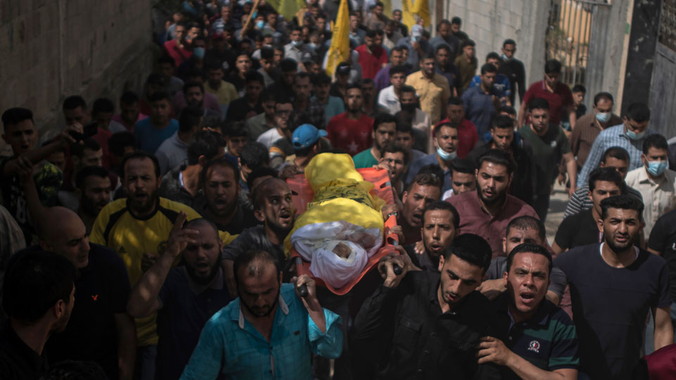 Mourners carry the body of 11-year-old