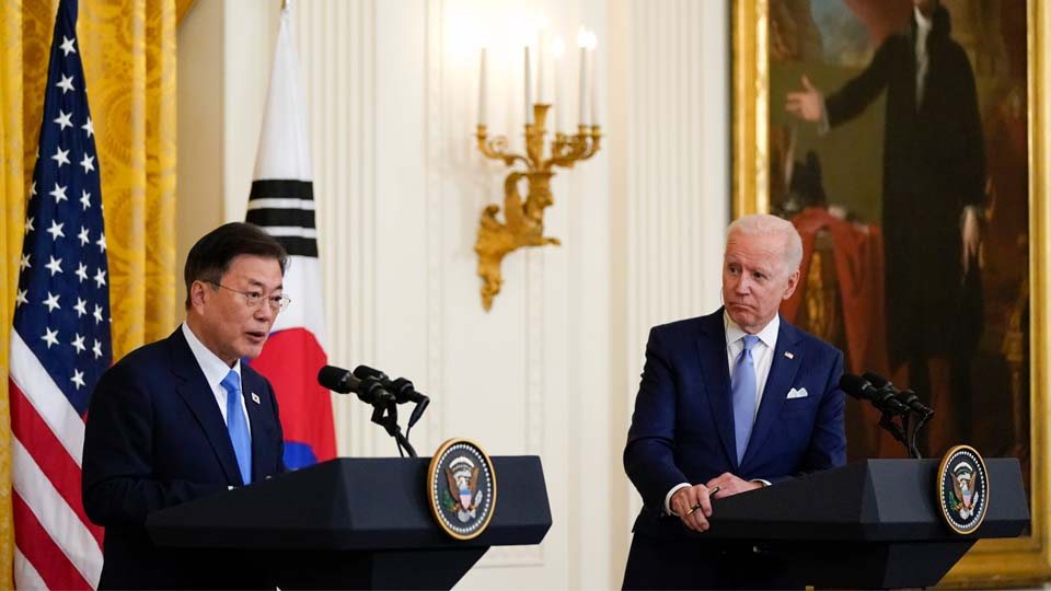 """FILE - In this May 21, 2021, file photo, President Joe Biden listens as South Korean President Moon Jae-in speaks during a joint news conference in the East Room of the White House, in Washington. North Korea said Monday, May 31, the U.S. allowing South Korea to build more powerful missiles was an example of the U.S.'s hostile policy against the North, warning that it could lead to an """"acute and instable situation"""" on the Korean Peninsula.(AP Photo/Alex Brandon, File)"""