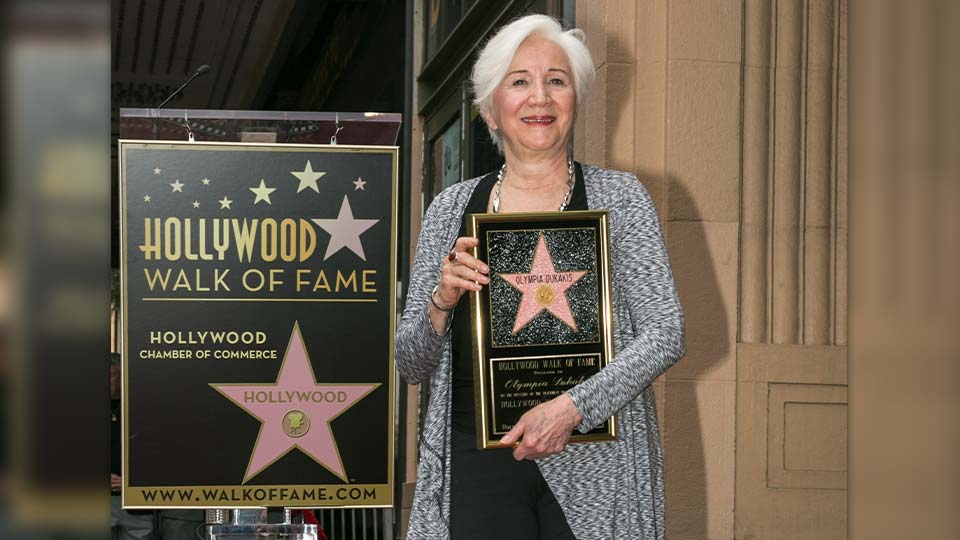 "In this May 24, 2013 file photo, Actress Olympia Dukakis is honored with a star on the Hollywood Walk of Fame for her stage work in front of the Pantages Theatre in Los Angeles. Olympia Dukakis, the veteran stage and screen actress whose flair for maternal roles helped her win an Oscar as Cher's mother in the romantic comedy ""Moonstruck,"" has died. She was 89."