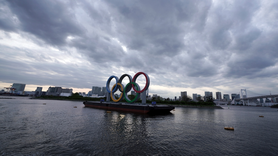 This April 12, 2021, file photo shows the Olympic rings floating in the water in the Odaiba section in Tokyo.