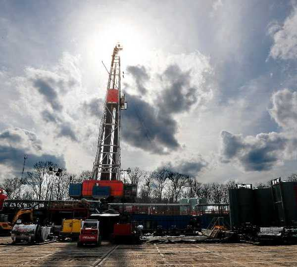 FILE - In this March 12, 2020, file photo, the sun shines through clouds above a shale gas drilling site in St. Mary's, Pa. In a late gambit to win the battleground state of Pennsylvania, President Donald Trump and his GOP allies have intensified attacks on Joe Biden over fracking, hoping to drive a wedge between the former vice president and the white, working-class voters tied to the state's booming natural gas industry.