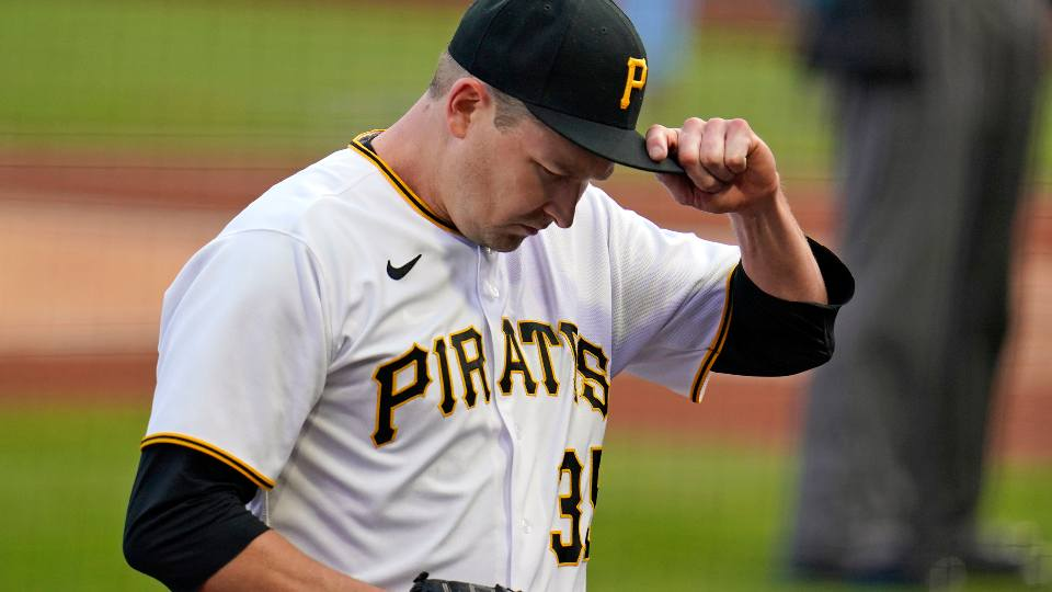Pittsburgh Pirates starting pitcher Trevor Cahill walks to the dugout after pitching the top of the first inning of the team's baseball game against the St. Louis Cardinals in Pittsburgh, Saturday, May 1, 2021.