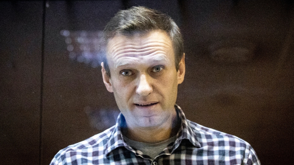 In this Saturday, Feb. 20, 2021, file photo, Russian opposition leader Alexei Navalny looks at photographers standing in the Babuskinsky District Court in Moscow, Russia.