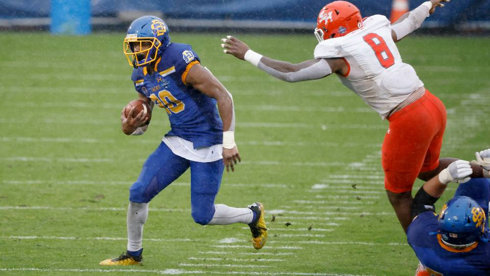 South Dakota State running back Pierre Strong Jr. (20) runs for yardage as Sam Houston State linebacker Quentin Brown (8) defends during the first half of the NCAA college FCS Football Championship in Frisco, Texas, Sunday, May 16, 2021.
