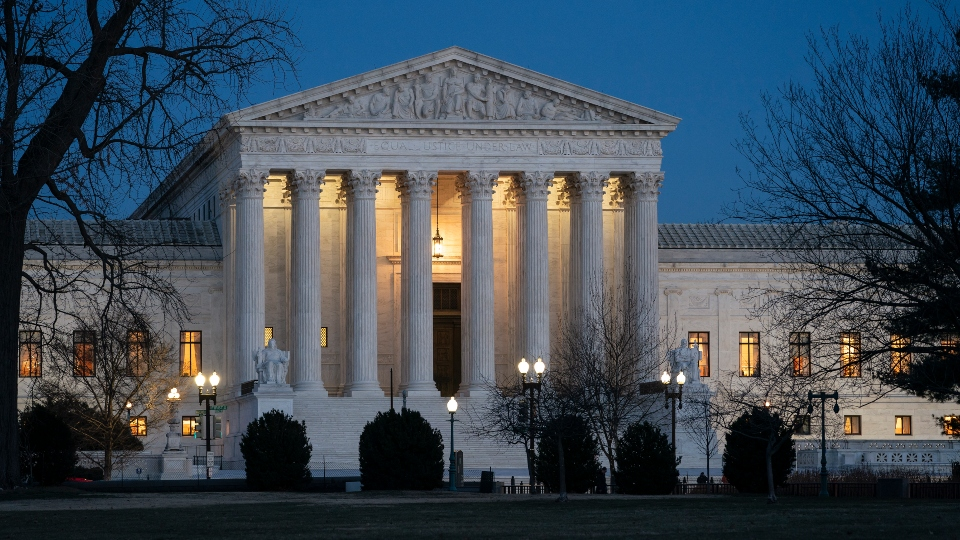 In this Jan. 22, 2020, file photo, night falls on the Supreme Court in Washington.