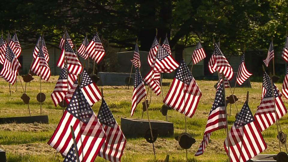 Volunteers gathered at Oak Park Cemetery in New Castle to place American flags on the gravesites of veterans.