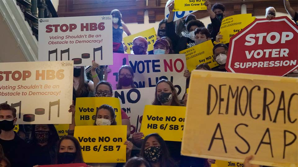 FILE - In this May 6, 2021 file photo, a group opposing new voter legislation gather outside the House Chamber at the Texas Capitol in Austin, Texas. Texas Republicans dug in Saturday, May 29, for a final weekend vote on some of the most restrictive new voting laws in the U.S., finalizing a sweeping bill that would eliminate drive-thru voting, reduce polling hours and scale back Sunday voting, when many Black churchgoers head to the polls.(AP Photo/Eric Gay, File)