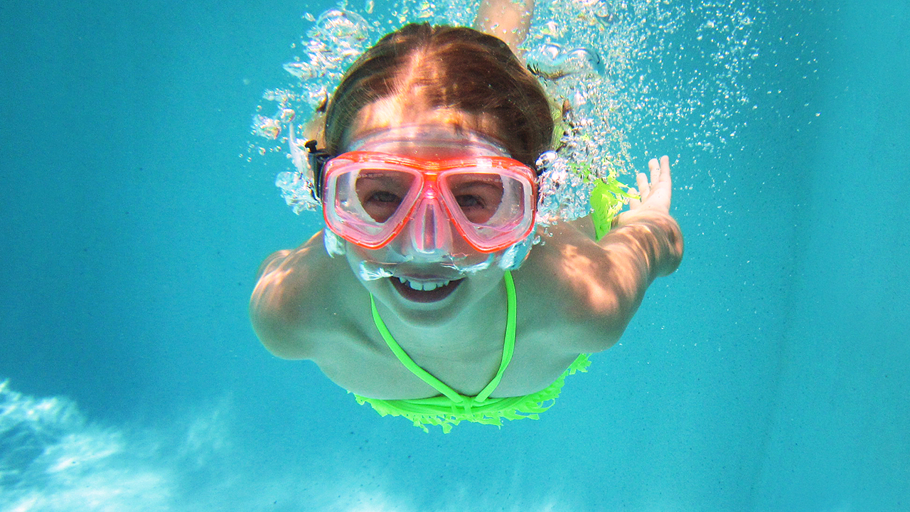 Young girl swimm