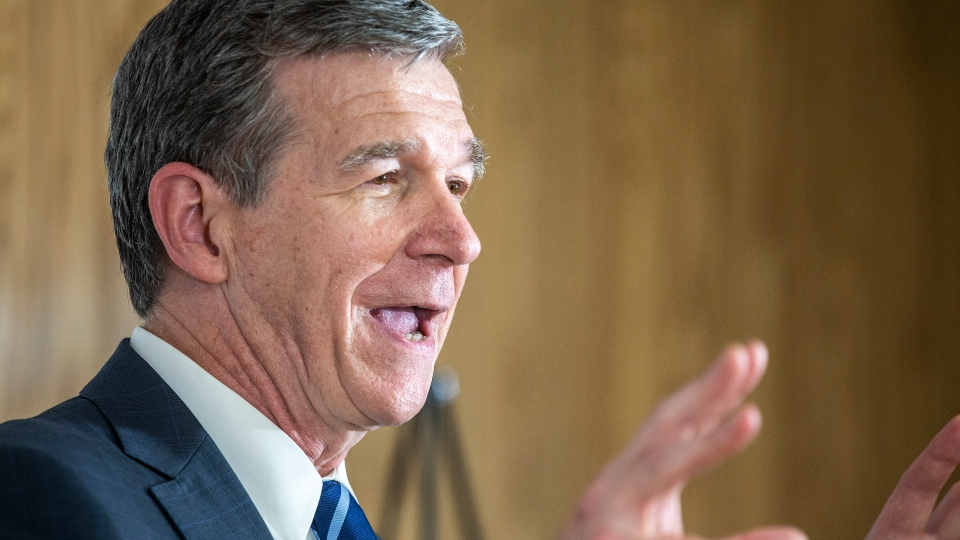 In this May 27, 2021 file photo, North Carolina Gov. Roy Cooper speaks to the gathered media after his tour of a COVID-19 vaccine clinic at the Pine Hall Brick plant in Madison, N.C.