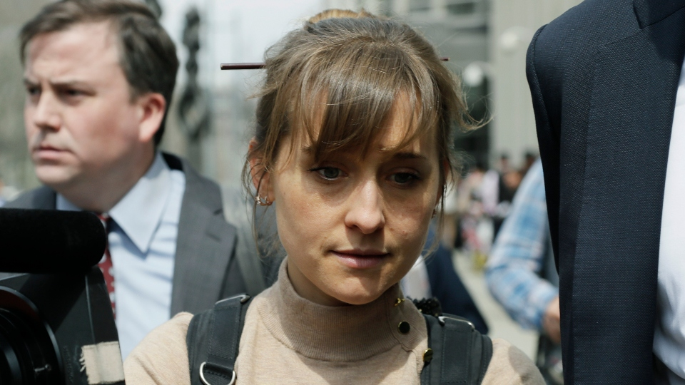 In this Monday, April 8, 2019, file photo, actress Allison Mack leaves Brooklyn federal court in New York.