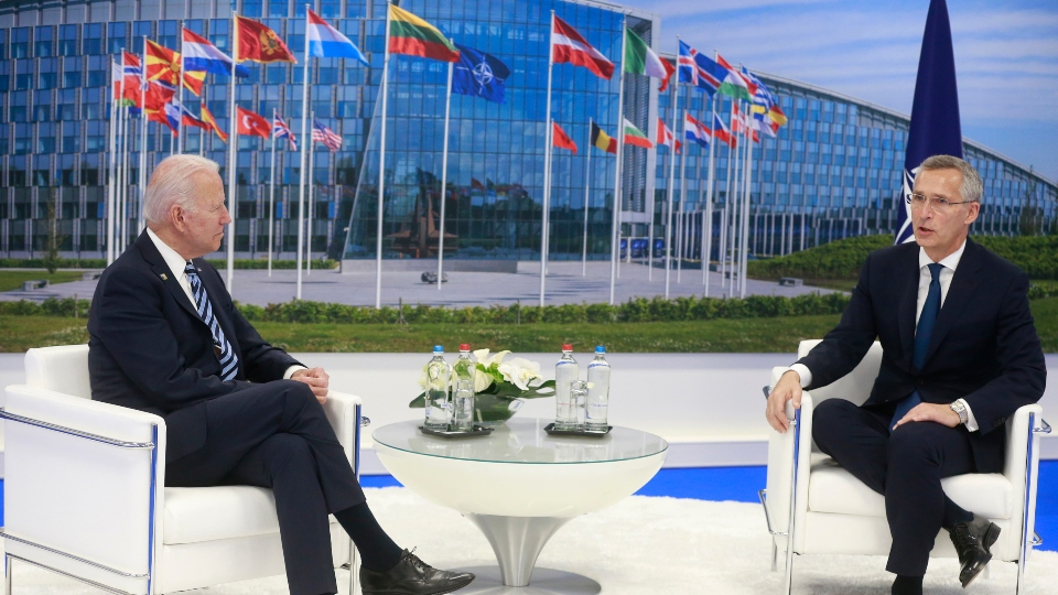 NATO Secretary General Jens Stoltenberg speaks with U.S. President Joe Biden during a bilateral meeting on the sidelines of a NATO summit at NATO headquarters in Brussels, Monday, June 14, 2021.