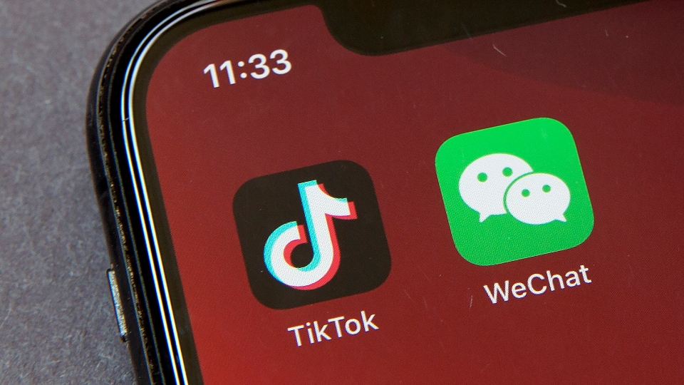 Icons for the smartphone apps TikTok and WeChat are seen on a smartphone screen in Beijing, in a Friday, Aug. 7, 2020 file photo.