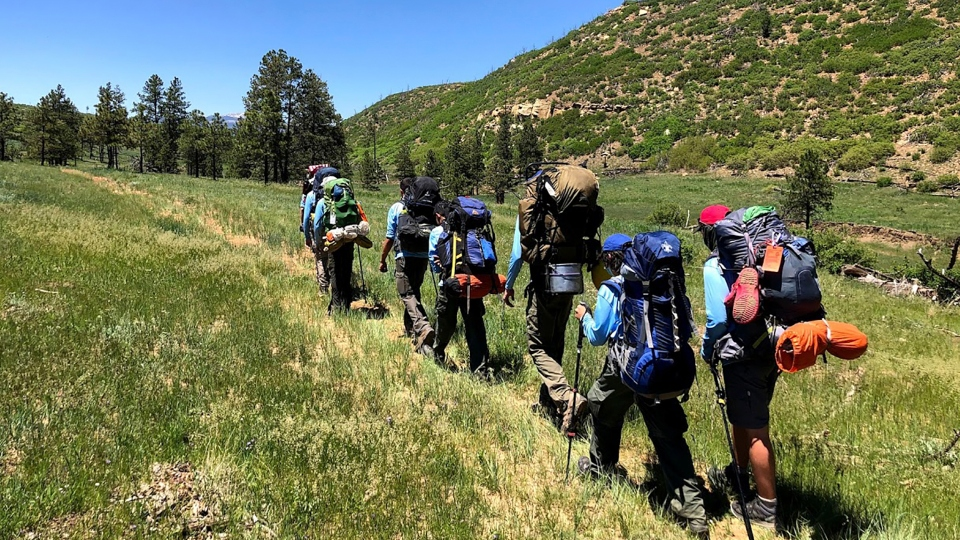 In this June 10, 2021 photo provided by Barry Bedlan, members of Troop 298 of Frisco, Texas are among the first to embark a 12-day trek across the Philmont Scout Ranch, outside Cimarron, N.M.