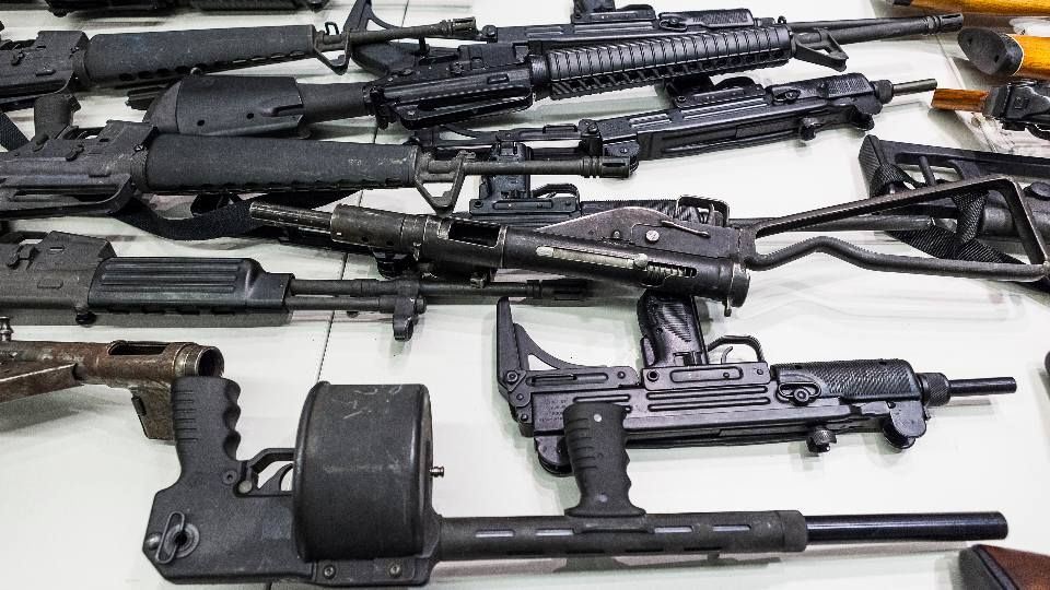 In this Dec. 27, 2012, file photo are some of the weapons that include handguns, rifles, shotguns and assault weapons, collected in a Los Angeles Gun Buyback event displayed during a news conference at the LAPD headquarters in Los Angeles. A federal judge has overturned California's three-decade-old ban on assault weapons, ruling that it violates the constitutional right to bear arms. U.S. District Judge Roger Benitez of San Diego ruled Friday, June 4, 2021, that the state's definition of illegal military-style rifles unlawfully deprives law-abiding Californians of weapons commonly allowed in most other states.