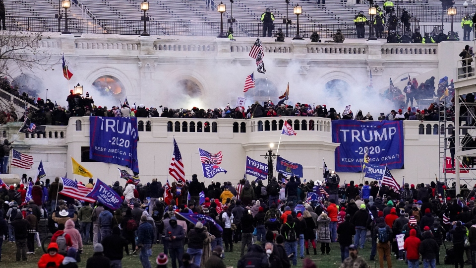 In this Jan. 6, 2021, file photo, violent rioters storm the Capitol, in Washington. The horror of Jan. 6 has been reduced from a stunning assault on American democracy to another political fight.