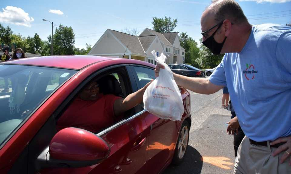 Scott Neely, a CHA staff member, distributing grab-and-go meals at a mobile meal site.