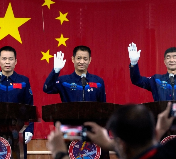 Chinese astronauts, from left, Tang Hongbo, Nie Haisheng, and Liu Boming wave at a press conference at the Jiuquan Satellite Launch Center ahead of the Shenzhou-12 launch from Jiuquan in northwestern China, Wednesday, June 16, 2021.