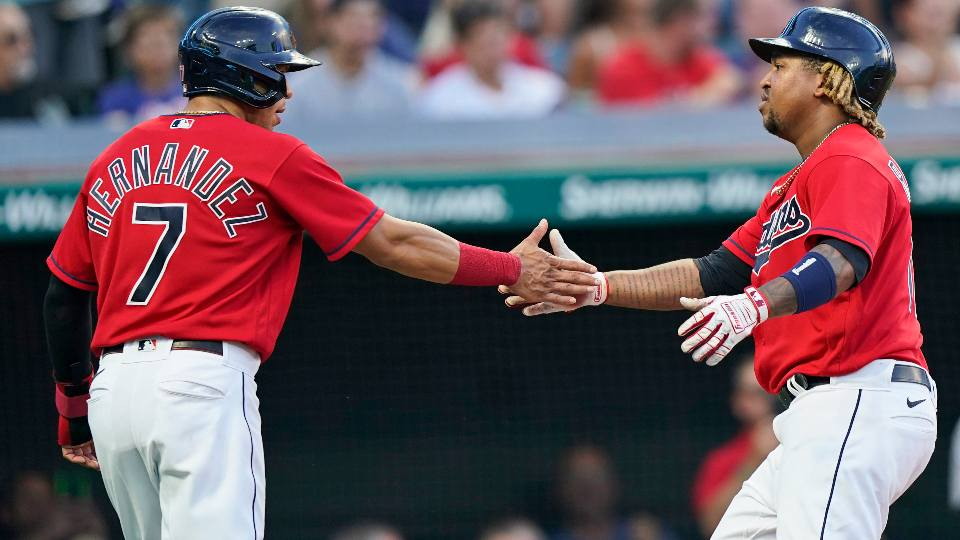 Cleveland Indians' Jose Ramirez, right, is congratulated by teammate Cesar Hernandez after hitting a three-run home run in the fourth inning of a baseball game against the Detroit Tigers, Monday, June 28, 2021, in Cleveland.