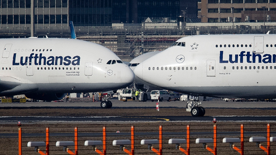 In this Feb.14, 2019 file photo, an Airbus A380, left, and a Boeing 747, both from Lufthansa airline pass each other at the airport in Frankfurt, Germany.