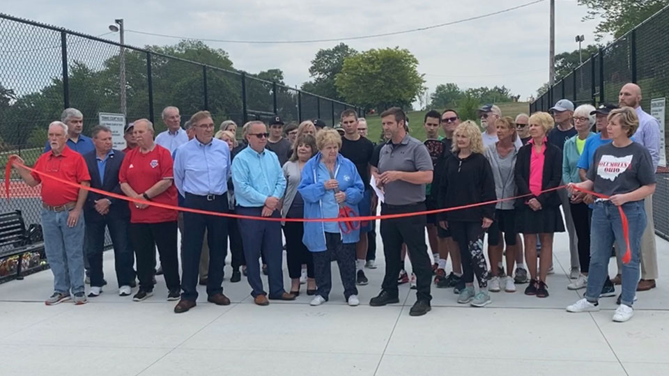 A ceremonial ribbon cutting ceremony was held at the sports courts in Firestone Park to open them to the public Wednesday evening