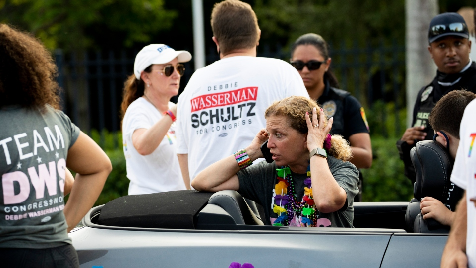 Rep. Debbie Wasserman Schultz, D-Fla., makes a call after a truck drove into a crowd of people during The Stonewall Pride Parade and Street Festival in Wilton Manors, Fla., Saturday, June 19, 2021.