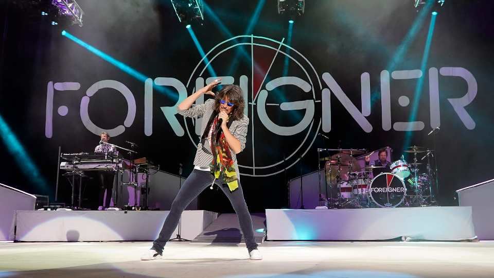 The British-American rock band Foreigner with keyboardist Michael Bluestein, lead vocalist Kelly Hansen and drummer Chris Frazier perform at the Blue Hills Bank Pavilion as part of The Juke Box Heroes Tour, Wednesday, June 20, 2018, in Boston.