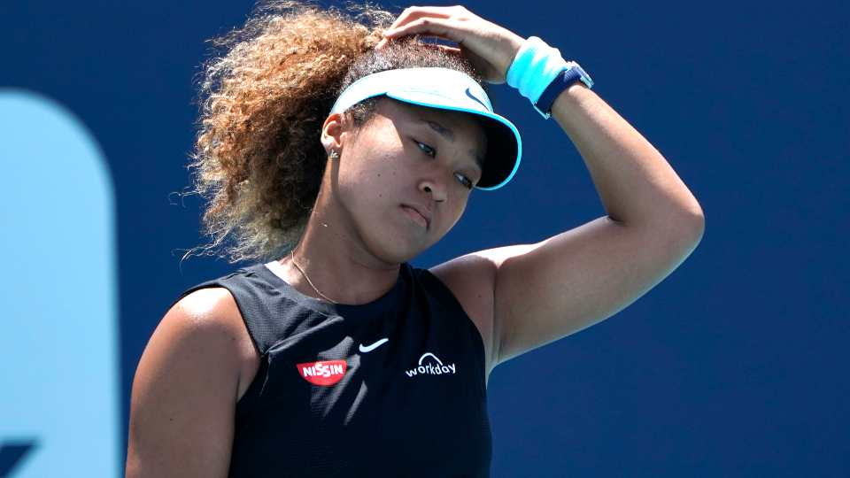 """Naomi Osaka, of Japan, reacts during her match against Maria Sakkari, of Greece, in the quarterfinals of the Miami Open tennis tournament in Miami Gardens, Fla., in this Wednesday, March 31, 2021, file photo. Sakkari won 6-0, 6-4. Naomi Osaka withdrew from the French Open on Monday, May 31, 2021, and wrote on Twitter that she would be taking a break from competition, a dramatic turn of events for a four-time Grand Slam champion who said she experiences """"huge waves of anxiety"""" before speaking to the media and revealed she has """"suffered long bouts of depression."""""""