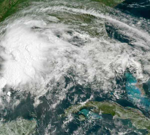 This GOES-16 GeoColor satellite image taken Friday, June 18, 2021, at 11 a.m. EDT, and provided by NOAA, shows a tropical weather system in the Gulf of Mexico. Officials ordered a floodgate and locks system closed in southeast Louisiana and readied sandbags in Mississippi and Alabama as a broad, disorganized tropical weather system began spinning bands of rain and brisk wind across the northern Gulf of Mexico coast Friday.