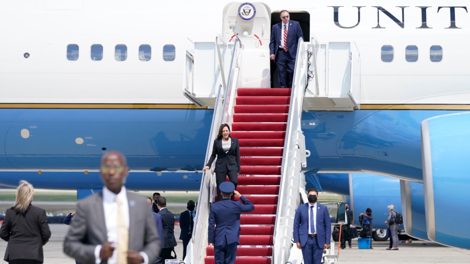 Vice President Kamala Harris is greeted by United States Air Force Lt. Col. Neil Senkowski as she deplanes Air Force Two after a technical issue forced the aircraft to return and land at Andrews Air Force Base, Md., Sunday, June 6, 2021, as she was en route to Guatemala City. (AP Photo/Jacquelyn Martin)