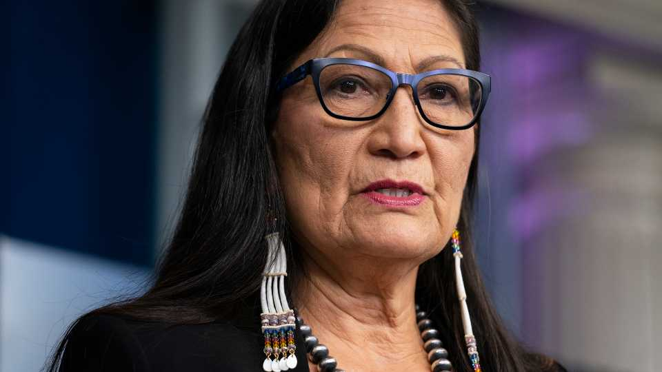 In this April 23, 2021, file photo, Interior Secretary Deb Haaland speaks during a news briefing at the White House in Washington. On Tuesday, June 22, 2021, Haaland and other federal officials are expected to announce steps that the federal government plans to take to reconcile the legacy of boarding school policies on Indigenous families and communities across the U.S.