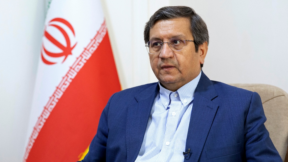 Former Iranian Central Bank chief Abdolnasser Hemmati, a candidate in Iran's upcoming presidential election, gives an interview to The Associated Press at his office in Tehran, Iran, Wednesday, June 9, 2021.