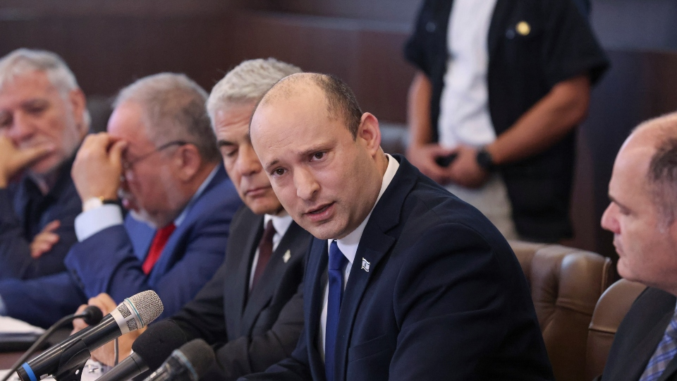 Israeli Prime Minister Naftali Bennett, center, chairs the first weekly cabinet meeting of the new government in Jerusalem, Sunday, June 20, 2021.