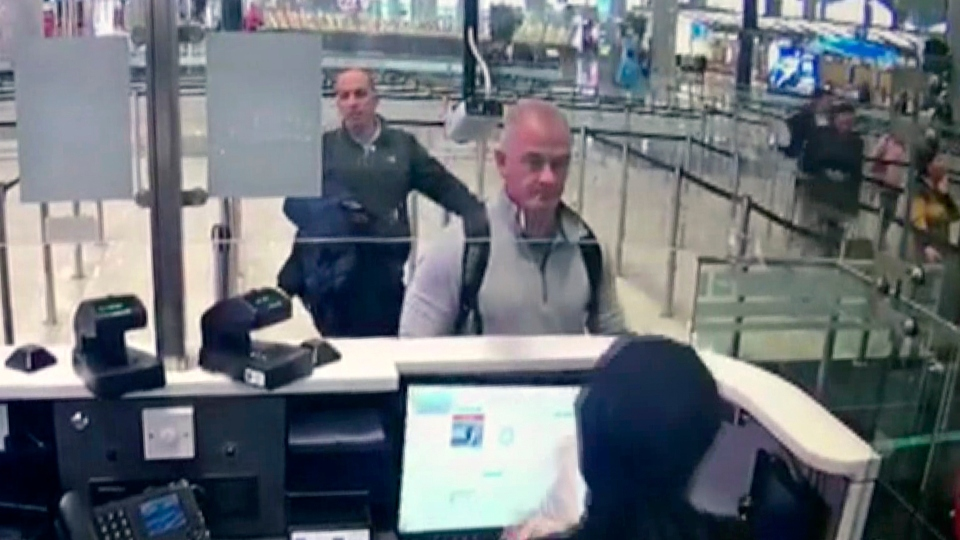 This Dec. 30, 2019 image from security camera video shows Michael L. Taylor, center, and George-Antoine Zayek at passport control at Istanbul Airport in Turkey.