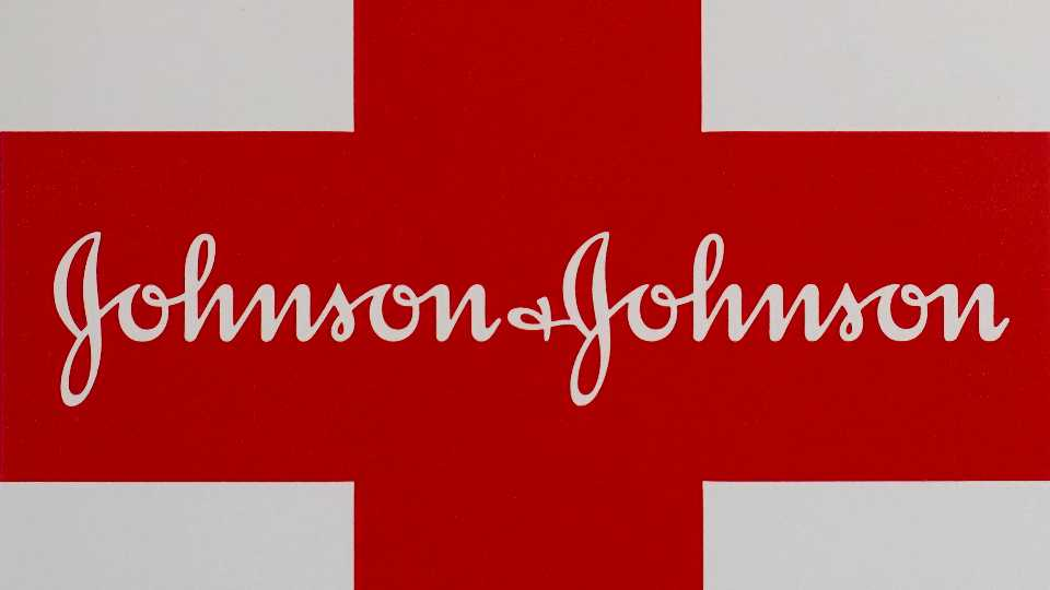 This Feb. 24, 2021 photo shows a Johnson & Johnson logo on the exterior of a first aid kit in Walpole, Mass. The New York attorney general says Johnson & Johnson has agreed to pay $230 million to settle claims that the pharmaceutical giant helped fuel the opioid crisis. The deal requires Johnson & Johnson to make a series of payments over nine years to cover total.