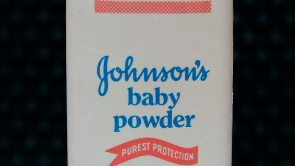 A bottle of Johnson's baby powder is displayed.