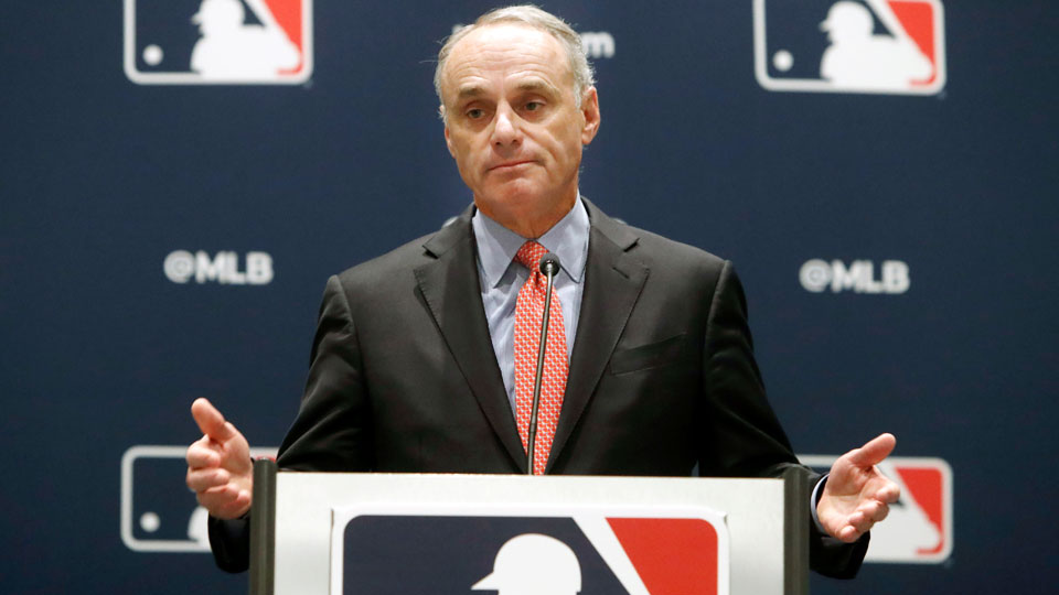 Rob Manfred speaks to the media at the owners meeting in Arlington, Texas