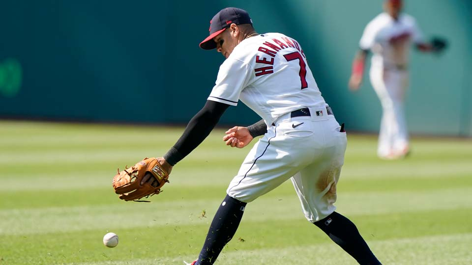 Cleveland Indians' Cesar Hernandez bobbles the ball in the third inning of a baseball game against the Seattle Mariners, Saturday, June 12, 2021, in Cleveland. Ty France was safe at first base. (AP Photo/Tony Dejak)