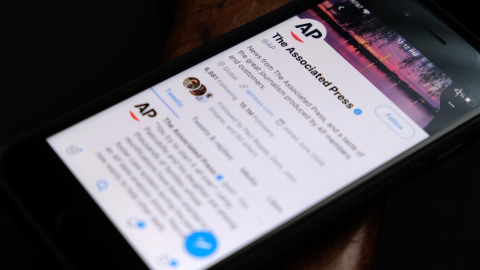 A cellphone displays The Associated Press Twitter account on Tuesday, June 8, 2021, in Los Angeles.