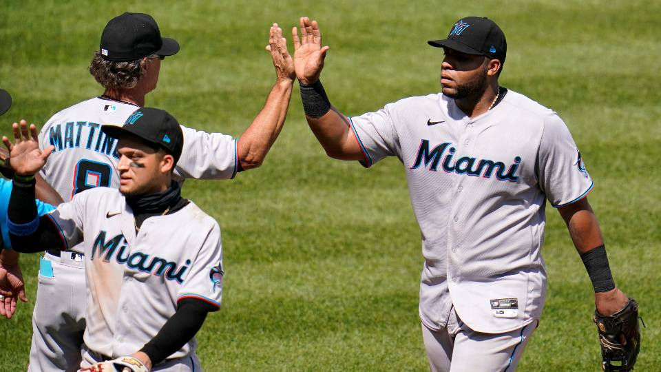 Miami Marlins first baseman Jesus Aguilar, right, is greeted by manager Don Mattingly as he walks off the field following a baseball game against the Pittsburgh Pirates in Pittsburgh, Sunday, June 6, 2021. The Marlins won 3-1.