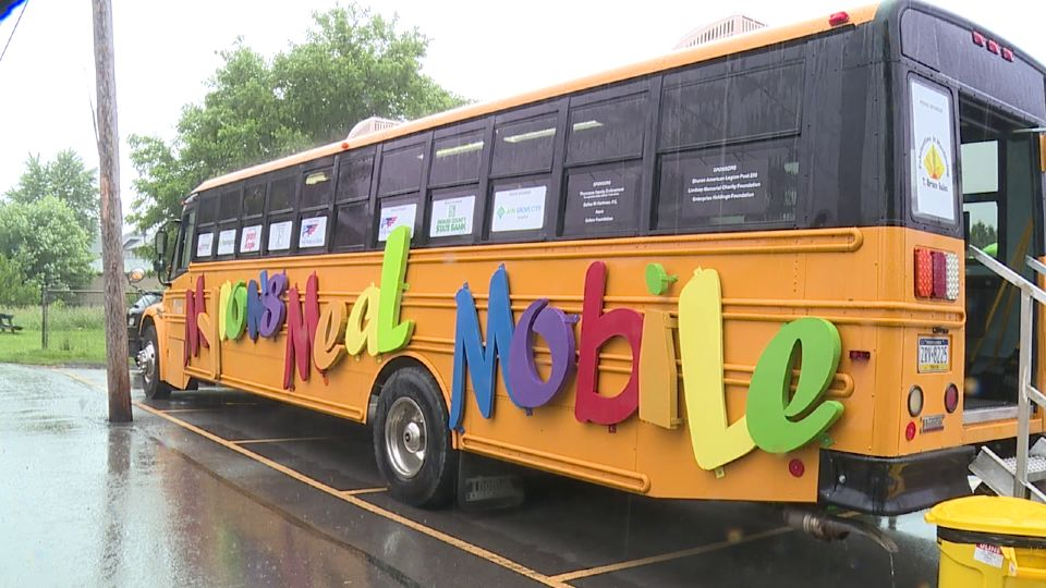 The rain didn't stop children and families from coming to the Community Food Warehouse meal bus Monday.