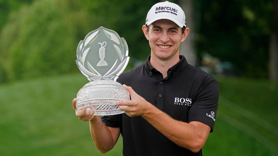 Patrick Cantlay holds the trophy after winning the Memorial golf tournament, Sunday, June 6, 2021, in Dublin, Ohio.