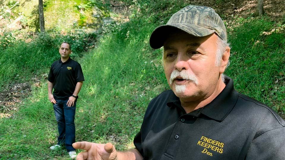 """FILE - This Sept. 20, 2018, file photo, Dennis Parada, right, and his son Kem Parada stand at the site of the FBI's dig for Civil War-era gold in Dents Run, Pa. Court documents unsealed Thursday, June 24, 2021, show that an FBI agent applied for a federal warrant in 2018 to seize a cache of gold that he said had been """"stolen during the Civil War"""" while en route to the U.S. Mint in Philadelphia. The Paradas, co-owners of the treasure-hunting outfit Finders Keepers, have said they believe the FBI found gold at the site and have pursued legal action to get more information. (AP Photo/Michael Rubinkam, File)"""