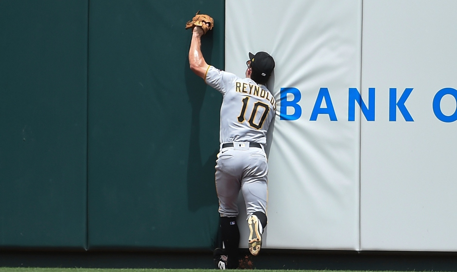 Pittsburgh Pirates center fielder Bryan Reynolds catches a fly ball hit by St. Louis Cardinals' Paul Goldschmidt during the third inning of a baseball game Saturday, June 26, 2021, in St. Louis. (AP Photo/Joe Puetz)