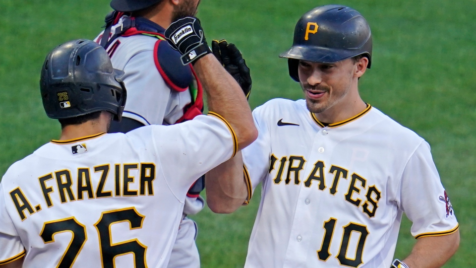Pittsburgh Pirates' Bryan Reynolds (10) celebrates with Adam Frazier (26) after hitting a three-run home run off Cleveland Indians relief pitcher James Karinchak during the seventh inning of a baseball game in Pittsburgh, Saturday, June 19, 2021. (AP Photo/Gene J. Puskar)